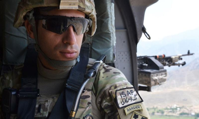 U.S. Army 1st. Lt. Florent A. Groberg, officer in charge for personal security detail, 4th Brigade Combat Team, 4th Infantry Division enjoys the view from a UH-60 Black Hawk helicopter traveling over the Kunar province July 16, 2012.    U.S. Army