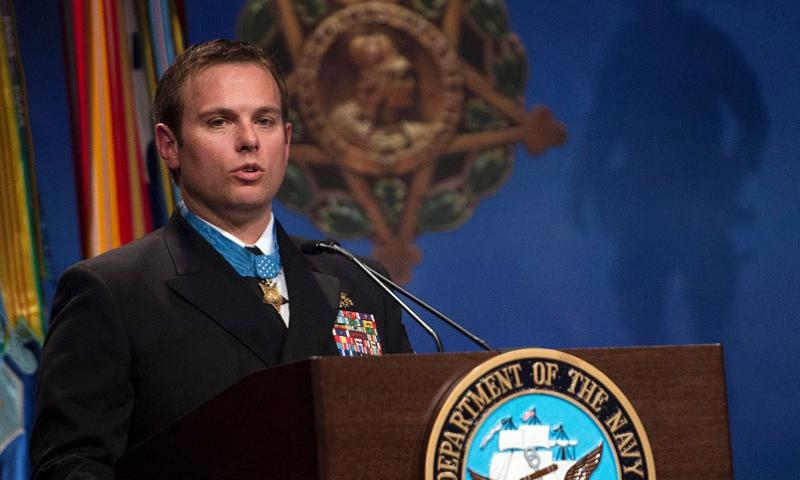 Medal of Honor recipient Navy SEAL Senior Chief Petty Officer Edward Byers provides remarks at the Medal of Honor ceremony honoring his heroism and valor during a Pentagon event on Tuesday, March 1, 2016.    Adrian Cadiz/U.S. Air Force
