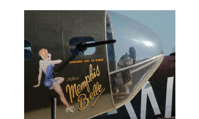 """The painted nose of the Memphis Belle, a B-17 Flying Fortress. The Air Force announced Friday it had found hundreds of examples of pornography and tens of thousands of other inappropriate items, including photos of painted aircraft nose art, listed under """"inappropriate/offensive."""" Haley Zimmerman/Courtesy of the U.S. Air Force"""