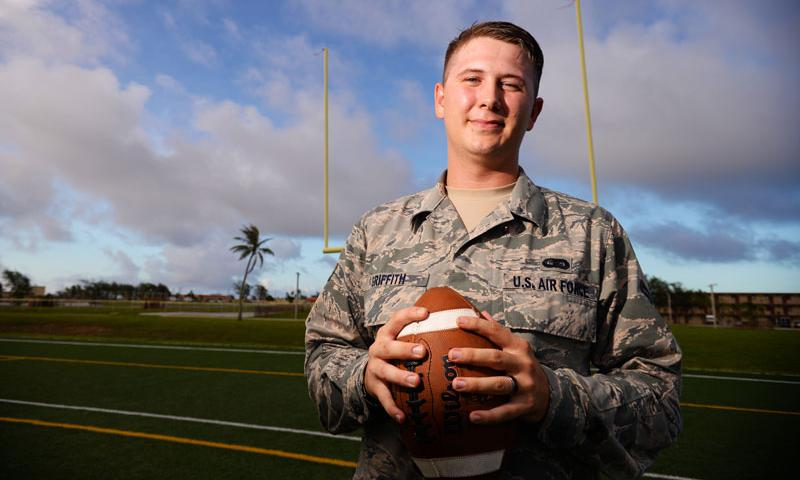 Senior Airman Presley Griffith, 36th Mobility Response Squadron executive assistant, offers a free football spring practice camp as volunteer coach at Andersen Air Force Base, Guam. A former high school quarterback, Griffith is working toward his goal of becoming a high school football coach. (U.S. Air Force photo by Senior Airman Alexander W. Riedel)