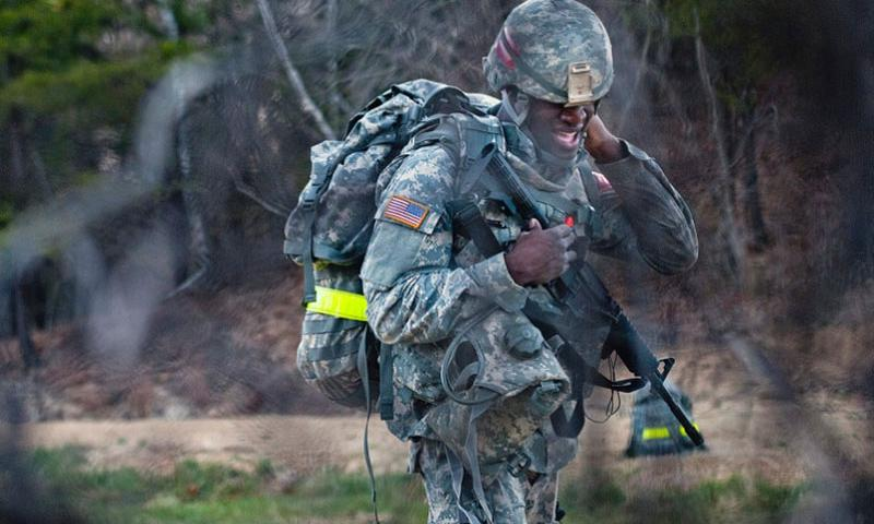 An Army Reserve soldier adjusts his equipment during a four-mile ruck march as part of the 2015 Combined TEC Best Warrior Competition at Fort McCoy, Wis., on April 28, 2015.    Debralee Best/U.S. Army