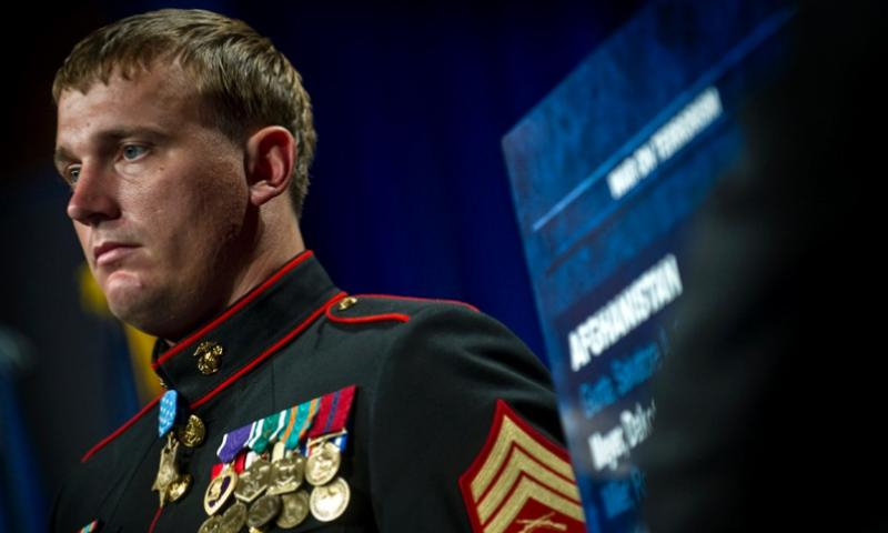 Medal of Honor recipient Marine Corps Sgt. Dakota Meyer stands at attention while his award citation is read at the Pentagon on Sept. 8, 2010. KEVIN O'BRIEN/U.S. NAVY