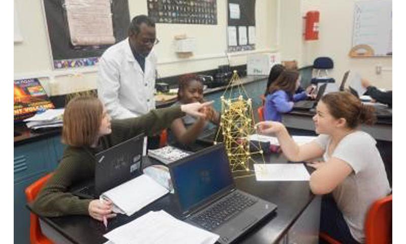Michael Pope interacts with his 8th grade students at Zama American Middle School in Camp Zama, Japan. Pope was selected as a state-level finalist in the Presidential Awards for Excellence in Mathematics and Science Teaching (PAEMST). (Photo courtesy of Jasmine Banks, Zama American MS)