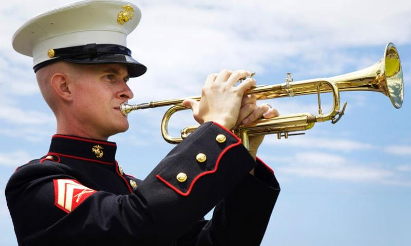 Cpl. Ronald Bellomy, Marine Forces Pacific Band, plays taps during a funeral service at the West Hawaii Veteran's Memorial Cemetery, Kona, Hawaii, in August, 2011.  U.S. Marines