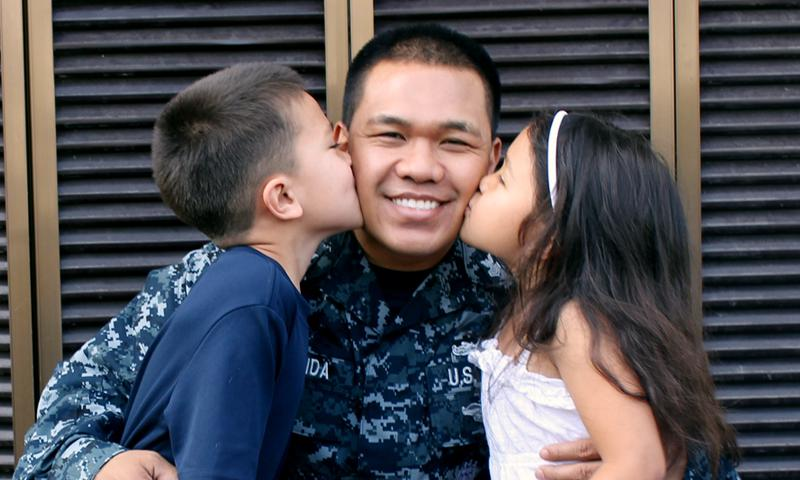 Petty Officer 1st Class Larrifour Hermida with son Aidan, 7, and Arianna, 5.