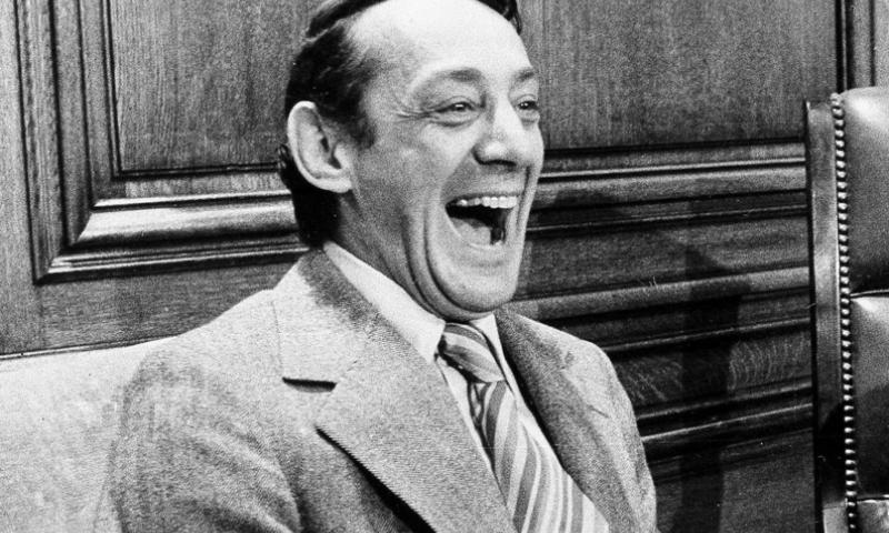 In this April 1977 file photo, San Francisco supervisor Harvey Milk sits in the mayor's office during the signing of the city's gay rights bill in San Francisco. The Navy is naming a ship in honor of the late gay rights leader, who served in the Navy for four years before he began a career in San Francisco city government. Navy Secretary Ray Mabus announced the decision to name the ship, which is one of a new fleet of replenishment oilers that will be built in San Diego. AP Photo/File