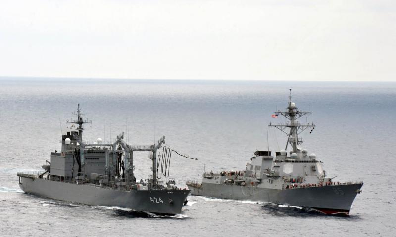 Japan Maritime Self-Defense Force fast-combat support ship JS Hamana, left, conducts a replenishment at sea with the guided-missile destroyer USS McCampbell, June 7, 2012, in the East China Sea. Japan has decided to develop and deploy a land-to-sea missile system designed to enhance defense in the East China Sea at the same time it is embroiled in a tense standoff with China over the disputed Senkaku island chain. Declan Barnes/U.S. Navy