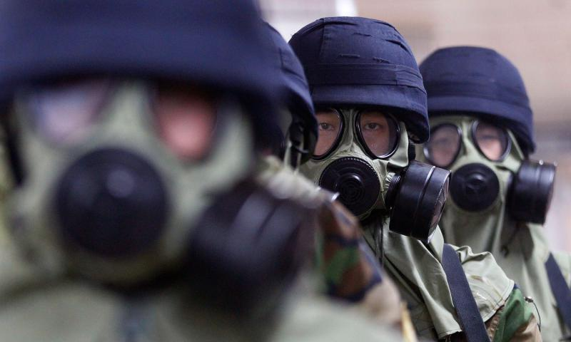South Korean police officers wearing gas masks conduct an anti-terror drill as part of Ulchi Freedom Guardian exercise, at Yoido Subway Station in Seoul, South Korea, Tuesday, Aug. 23, 2016. South Korea and the United States began annual military drills Monday despite North Korea's threat of nuclear strikes in response to the exercises that it calls an invasion rehearsal. Ahn Young-joon/AP Photo