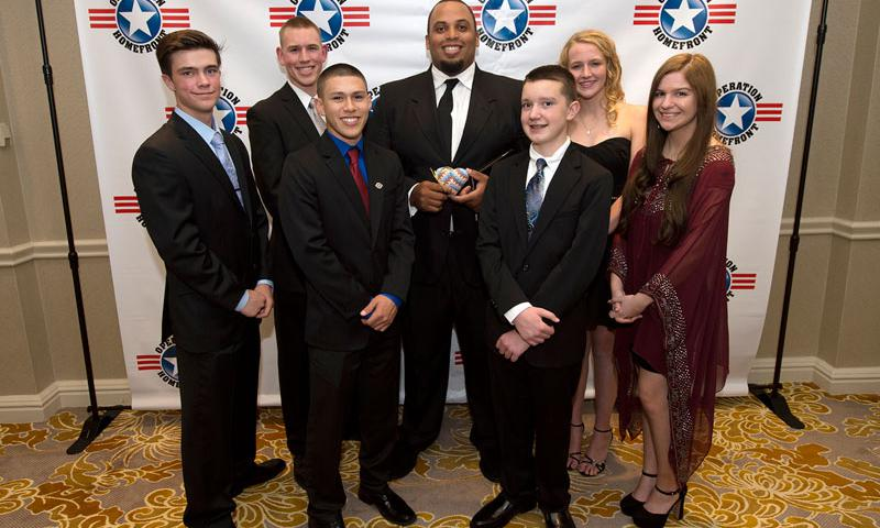 Military Child of the Year Award recipients stand with former professional athlete Jason Brown, center, before the award ceremony April 16, 2015 in Arlington, Va. From left are Zach Parsons, Caleb Parsons, Christopher-Raul Rodriguez, Brown, Cavan McIntyre-Brewer, Emily Kliewer, and Sarah Hesterman. DoD photo by EJ Hersom