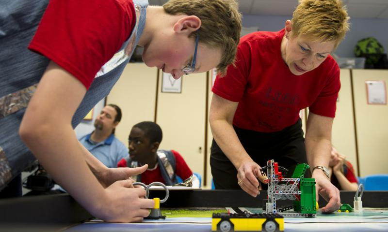 Elizabeth Quinn, right, a gifted resource educator, and Albert Vandeway, a fourth-grade student at Kaiserslautern Elementary School, make adjustments to Lego obstacles during a DODEA-Europe robotics competition for 10- to 14-year-old students in Kaiserslautern, Germany, on Monday, March 28, 2016. Michael B. Keller/Stars and Stripes