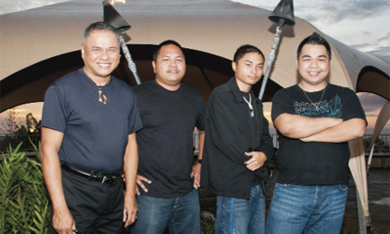 Naval Facilities Engineering Command Supervisory Management Analyst Raymond Miranda, left, takes a quick photo opportunity with his sons at the Top O' the Mar in Asan Aug. 24. Miranda has a musical talent that he shares with his family, local and military communities. U.S. Navy photo by Shaina Marie Santos/Released
