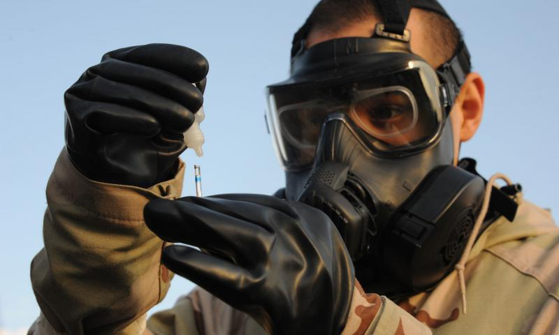 An airman tests water for chemical agents during an exercise.  DAVID MURPHY/U.S. AIR FORCE PHOTO