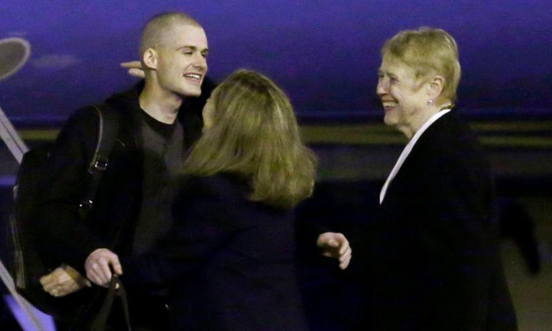 Matthew Miller, left, who had been held in North Korea since April, 2014, is greeted after arriving Saturday, Nov. 8, 2014, at Joint Base Lewis-McChord, Wash., after he was freed during a top-secret mission.  Ted S. Warren/AP