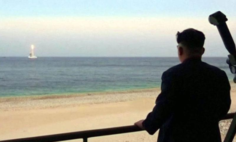 This video screenshot purports to show North Korean leader Kim Jong Un watching a submarine-launched ballistic missile test in August 2016. SCREENSHOT FROM NDN