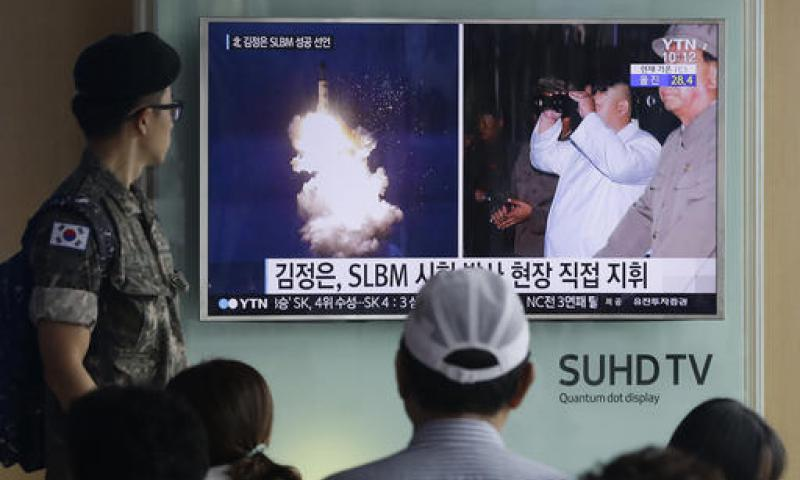 In this Thursday, Aug. 25, 2016, file photo, a South Korean army soldier watches a TV news program showing images published in North Korea's Rodong Sinmun newspaper of North Korea's ballistic missile believed to have been launched from underwater and North Korean leader Kim Jong-un, at Seoul Railway station in Seoul, South Korea. Ahn Young-joon/AP