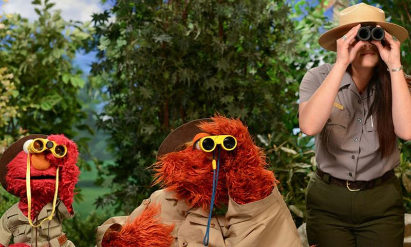 Elmo, Murray, and Park Ranger Amala fFrom Grand Canyon National Park, in a promotional photo for Sesame Street's partnership with the National Park Service. Photo courtesy of Sesame Workshop