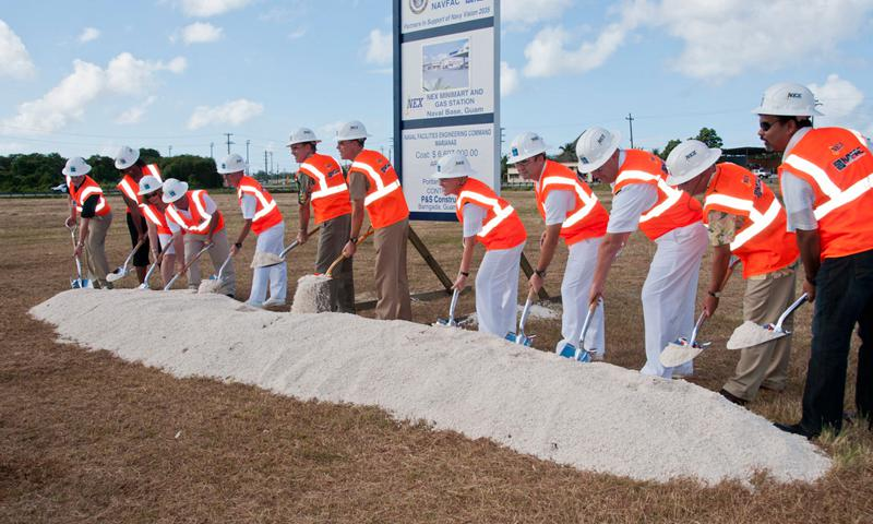SANTA RITA, Guam (Dec. 19, 2012) – U.S. Naval Base Guam (NBG) Commanding Officer Capt. Mike Ward, center, is joined by Naval Facilities Engineering Command Marianas representatives and others as they break ground for the new Navy Exchange Guam Mini-mart and Gas Station on the base Dec. 19. Patrons can look forward to a new, modernized facility in the coming year to be built across from the NBG fire station. (U.S. Navy photo by Shaina Marie Santos)