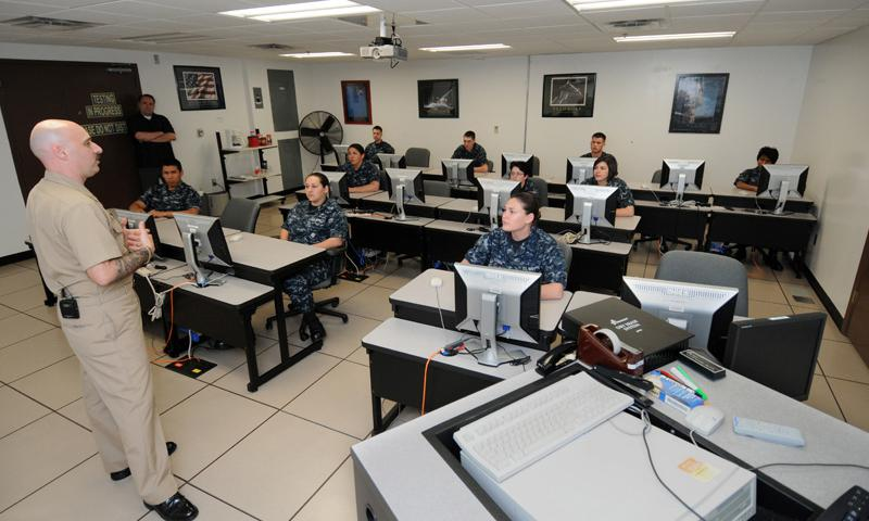 """PENSACOLA, Fla. (March 29, 2012) Chief Petty Officer S.F. """"Doc"""" Wallach, advanced schools division leading CPO for Center for Information Dominance (CID) Unit Corry Station, speaks to students about educational opportunities available to them through the Navy during a period of general military training. (U.S. Navy photo by Gary Nichols)"""