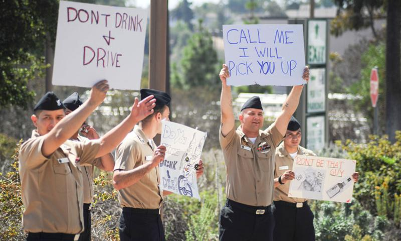 SAN DIEGO (Aug. 29, 2014) Sailors assigned to Naval Medical Center San Diego hold signs encouraging other Sailors to not drink and drive. The Same Day, No Way and Keep What You've Earned rally was sponsored by the drug and alcohol programs advisor at the medical center to encourage those leaving base to make safe decisions. (U.S. Navy photo by Mass Communication Specialist 3rd Class Pyoung K. Yi)
