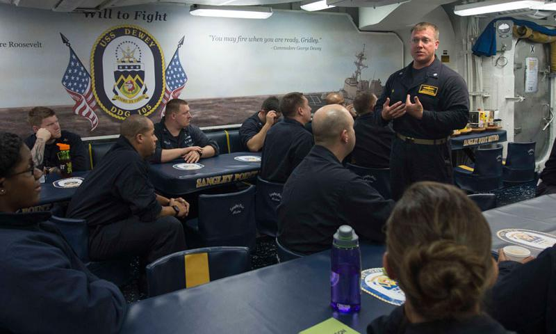 PACIFIC OCEAN (Sept. 15, 2014) Cmdr. Mikael A. Rockstad, commanding officer of the Arleigh Burke-class guided-missile destroyer USS Dewey (DDG 105), speaks to the First Class Petty Officer Association about the results of the command's climate survey. Dewey is on deployment with the Carl Vinson Carrier Strike Group in the U.S. 7th Fleet area of responsibility supporting Valiant Shield. (U.S. Navy photo by Mass Communication Specialist 3rd Class James Vazquez)
