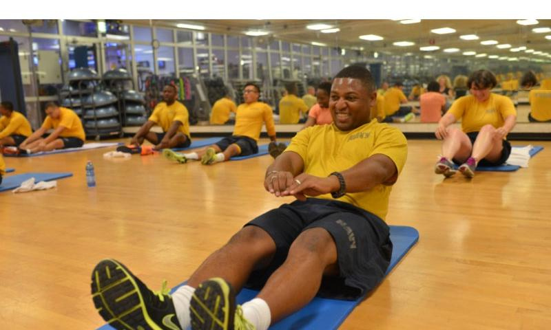 Petty Officer 1st Class Love Harris, an electronics technician, participates in a Fitness Enhancement Program class on August 5, 2015. Harris failed the Navy's fitness assessment when he first arrived in Naples but has been in standards since and is now training to be an assistant fitness leader for his command.    Steven Beardsley/Stars and Stripes