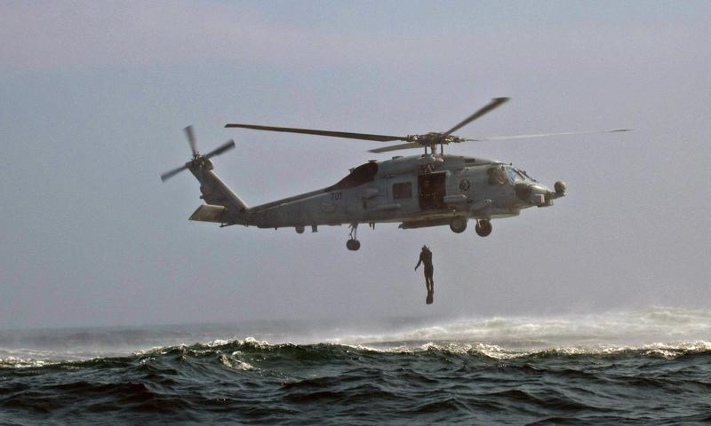 YELLOW SEA (May 8, 2014) Chief Sonar Technician (Surface) Jeffery Fischer jumps from an MH-60R Sea Hawk helicopter assigned to Helicopter Maritime Strike Squadron (HSM) 78 during search and rescue swimmer training with the Arliegh-burke class guided missile destroyer USS Wayne E. Meyer (DDG 108). (U.S. Navy photo by Gas Turbine System Technician (Mechanical) 2nd Class Gary Robinson)