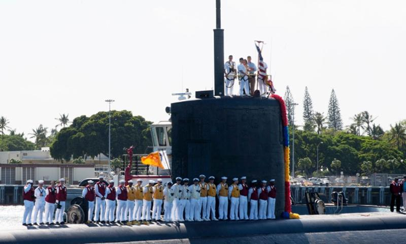 Crew members stand aboard the Los Angeles-class fast attack submarine USS Santa Fe as it returns home to Pearl Harbor on Oct. 28, 2015. Santa Fe is returning to Joint Base Pearl Harbor-Hickam after completing a six-month deployment to the western Pacific Ocean.     Jeff Troutman/U.S. Navy
