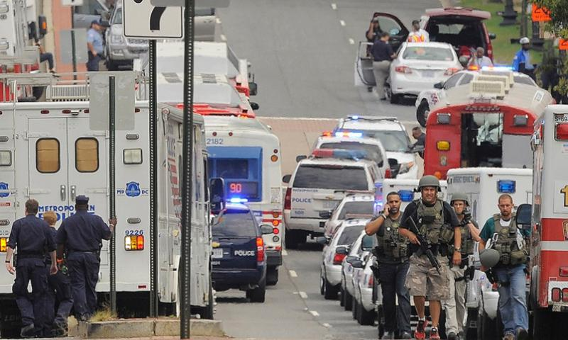 Law enforcement personnel converged on the Washington Navy Yard on Sept. 16, 2013 after reports of mass shooting. Matt McClain/The Washington Post