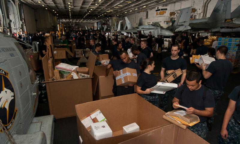 GULF OF OMAN (June 29, 2013) Sailors sort mail aboard the aircraft carrier USS Nimitz (CVN 68) while conducting a replenishment-at-sea. (U.S. Navy photo by Mass Communication Specialist 3rd Class Raul Moreno Jr.)