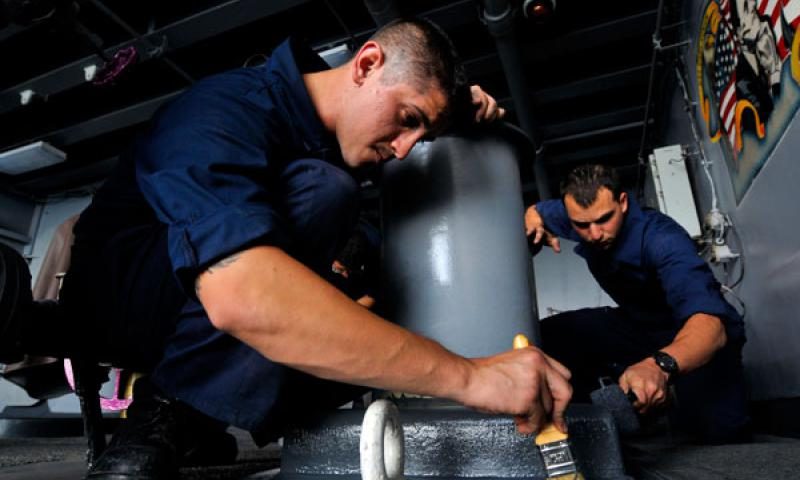 ARABIAN SEA (March 21, 2012) Seaman Miguel Delatorre, left, and Seaman Andrew Boyajian, both assigned to the Deck Department's 2nd Division, paint a refueling at sea station aboard the Nimitz-class aircraft carrier USS Carl Vinson (CVN 70). U.S. Navy photo by Mass Communication Specialist Seaman George M. Bell
