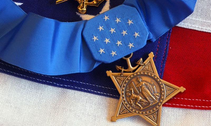 The Medal of Honor rests on a flag during preparations for an award ceremony.  Brandan W. Schulze/U.S. Navy
