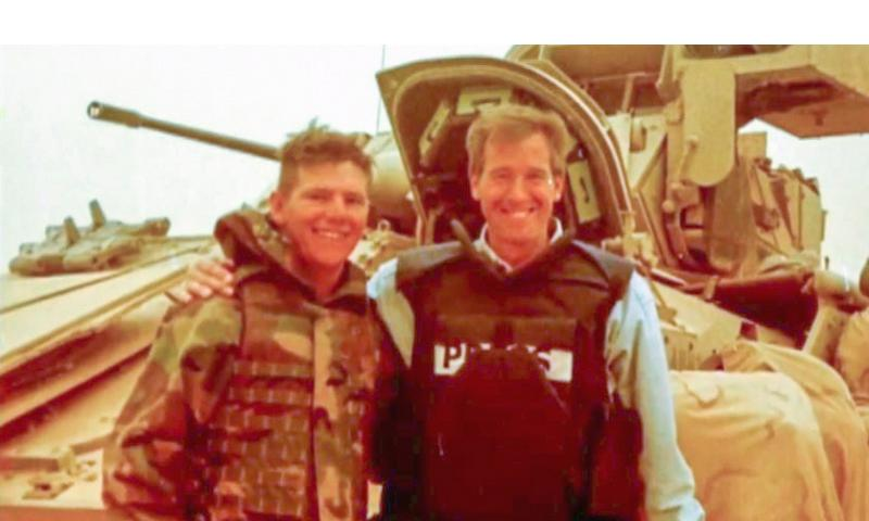 A video screen grab shows news anchor Brian Williams posing with Command Sgt. Major Tim Terpack in an NBC Nightly News report broadcast on Jan. 30, 2015. NBC YouTube