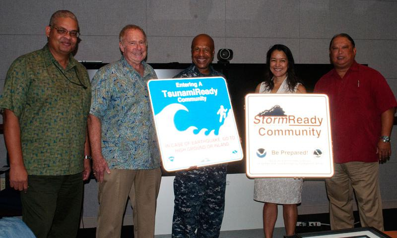 """SANTA RITA, Guam (April 13, 2015) -- U.S. Naval Base Guam has been recognized as a """"StormReady/TsunamiReady (SR/TR)"""" unit by the National Oceanographic and Atmospheric Administration (NOAA)/National Weather Service (NWS), and the United States Department of Commerce, in a ceremony here April 13 at 12:30 p.m.  Naval Base Guam (NBG) received the certificate for being recognized for meeting the NOAA's high standards of becoming a StormReady and TsunamiReady organization.  (U.S. Navy photo by Jeff Landis)"""