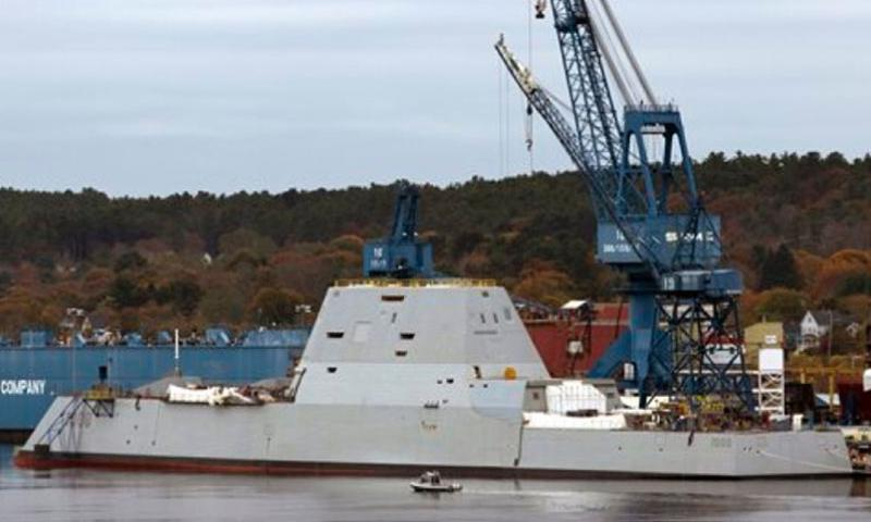 In this Oct. 31, 2013 file photo the Navy's stealthy Zumwalt destroyer is built at Bath Iron Works, in Bath, Maine. The Navy's largest destroyer cuts an imposing figure: massive in size, with an angular shape, hidden weapons, and an unusual hull that fell out of favor a century ago in part because it can be unstable.     Robert F. Bukaty/AP