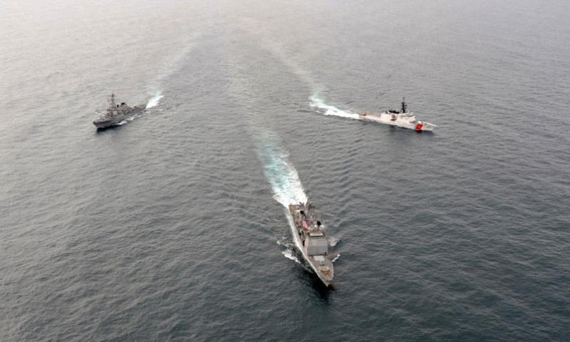 The USS Lake Erie, front, an Aegis-class guided missle-cruiser homeported in Pearl Harbor and the USS Decatur, an Arleigh Burke-class guided-missle destroyer homeported in San Diego and the Coast Guard Cutter Bertholf, a national security cutter homeported in Alameda, Calif., transit the Gulf of Alaska in 2011.  Charly Hengen/U.S. Navy photo