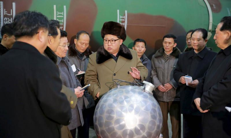In March 2016, North Korea's Rodong Sinmun newspaper published photos purporting to show leader Kim Jong Un and the country's nuclear scientists standing near what some analysts said appears to be a model nuclear warhead with a ballistic missile, or a model of one, in the background. Courtesy of KCNA