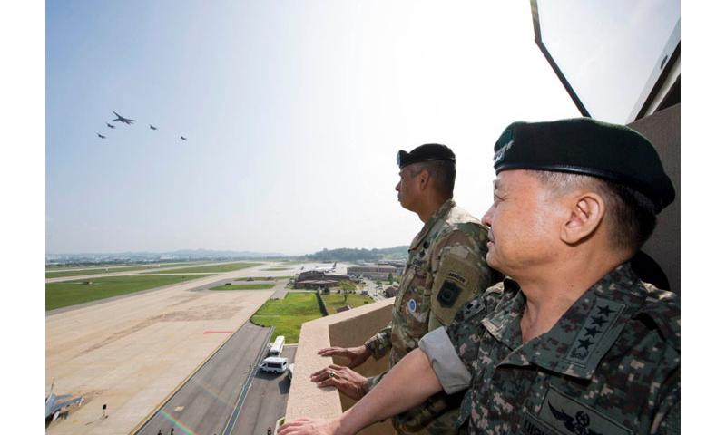 Gen. Vincent Brooks, U.S. Forces Korea commander, and South Korean army Gen. Lee Sun-jin watch an Air Force B-1B Lancer, escorted by South Korean fighter jets, performing a flyover at Osan Air Base, South Korea, Sept. 13, 2016. Victor Caputo/U.S. Air Force