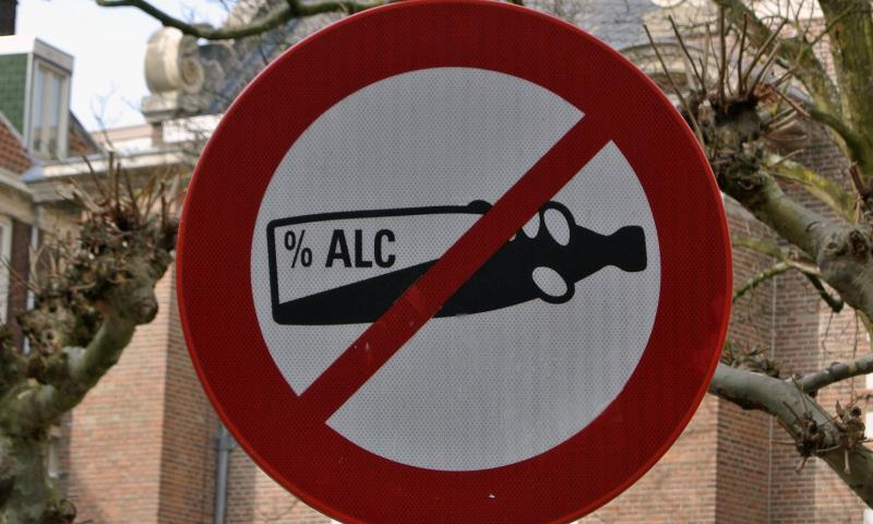 A churchyard sign in Amsterdam says it is forbidden to drink alcohol there.  Michael Abrams/Stars and Stripes