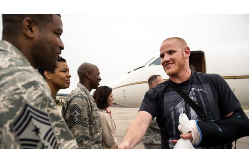 U.S. Air Force Airman 1st Class Spencer Stone meets Chief Master Sgt. Phillip Easton, 86th Airlift Wing command chief, upon his arrival to Ramstein Air Base, Germany, Aug. 24. 2015. Sara Keller/U.S. Air Force