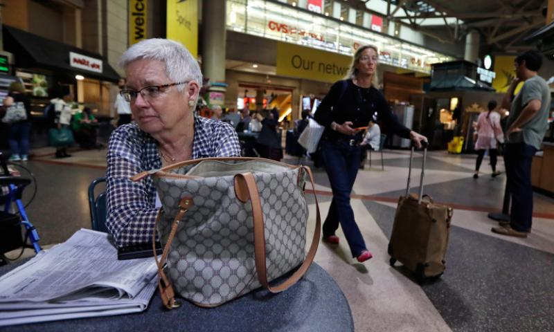 Mary Ellen Monico, 69, of Meredith, N.H. sits during an interview regarding fears of terrorism while waiting for a train at the South Station, Monday, Sept. 19, 2016, in Boston.     Charles Krupa/AP