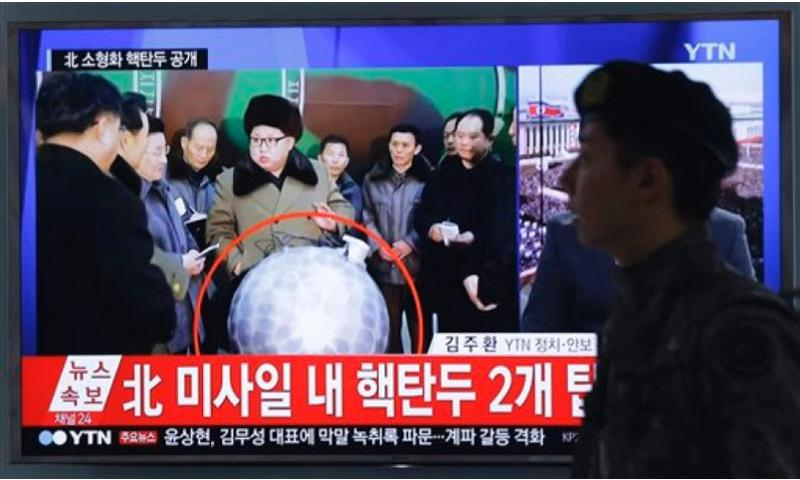 "A South Korean army soldier walks by a TV screen showing North Korean leader Kim Jong Un with superimposed letters that read: ""North Korea's nuclear warhead"" during a news program at Seoul Railway Station in Seoul, South Korea, Wednesday, March 9, 2016. The official North Korean news agency says the communist country's leader Kim met his nuclear scientists for a briefing and declared he was greatly pleased that warheads had been miniaturized for use on ballistic missiles.   Ahn Young-joon/AP"