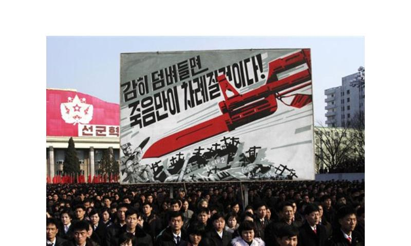 North Koreans attend a rally March 7, 2013, to support a statement given a few days earlier vowing to cancel the 1953 cease-fire that ended the Korean War. North Korea is also threatening to launch a preemptive nuclear strike against the United States.  Jon Chol Jin/AP