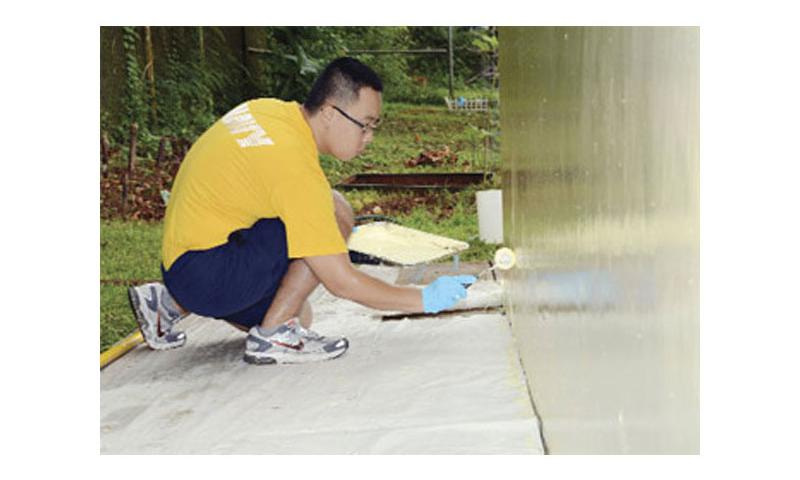 Fresh and So Clean: Seaman Ha Young, of Navy Operational Support Center (NOSC) Guam, paints the outside of Mangilao Karidat A during a community service project in Mangilao Sept. 20. U.S. Navy photo by Mass Communication Specialist 2nd Class Jeremy Starr/Released