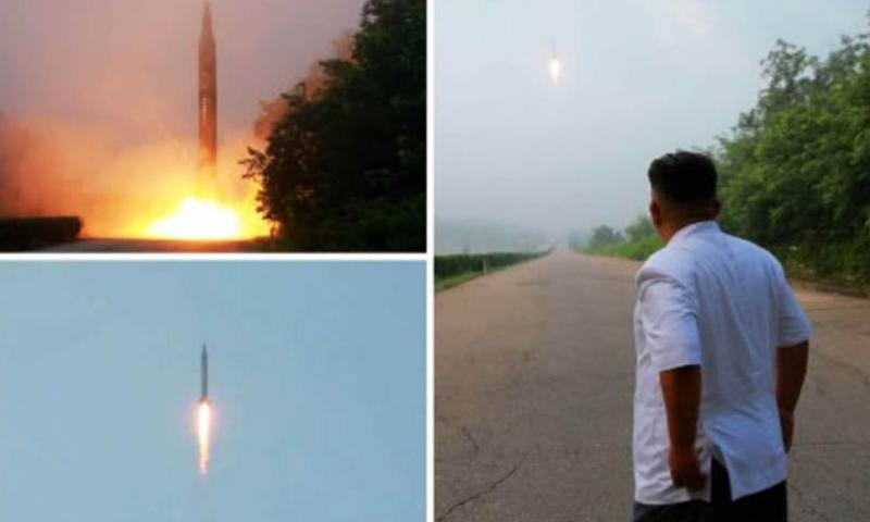 North Korea's official ruling Workers' Party newspaper, Rodong Sinmun, carried photographs of a ballistic missile launch along with leader Kim Jong Un apparently observing it.