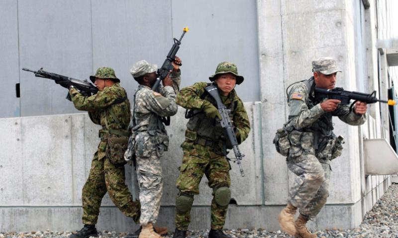 Training exercises like this one, with members of the New York National Guard and the Japanese Ground Self-Defense Force in Shiga Prefecture, Japan, in 2009, simulate what would be illegal under Japanese law in a real overseas war: collective self-defense. NEW YORK NATIONAL GUARD