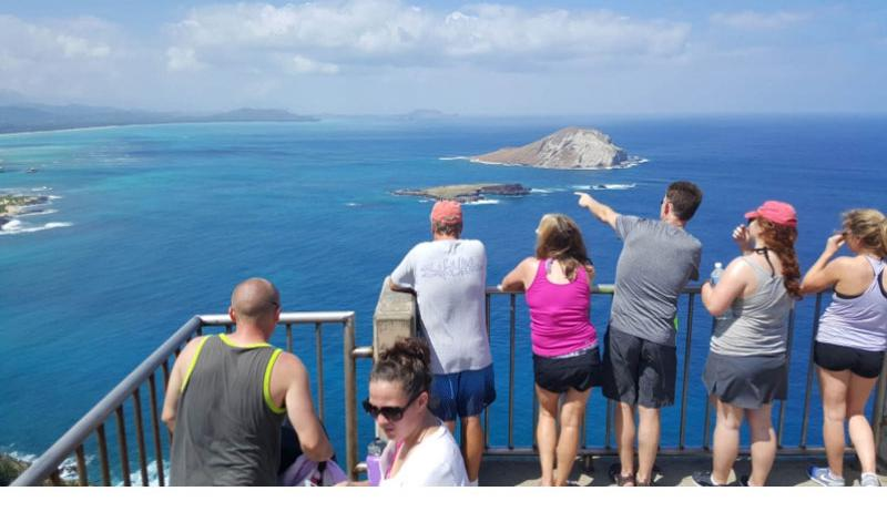Hikers in Hawaii view islands and whales after reaching the paved summit of the Makapu'u Lighthouse Trail on Oahu. Rocky paths lead to higher elevations.  Wyatt Olson/Stars and Stripes