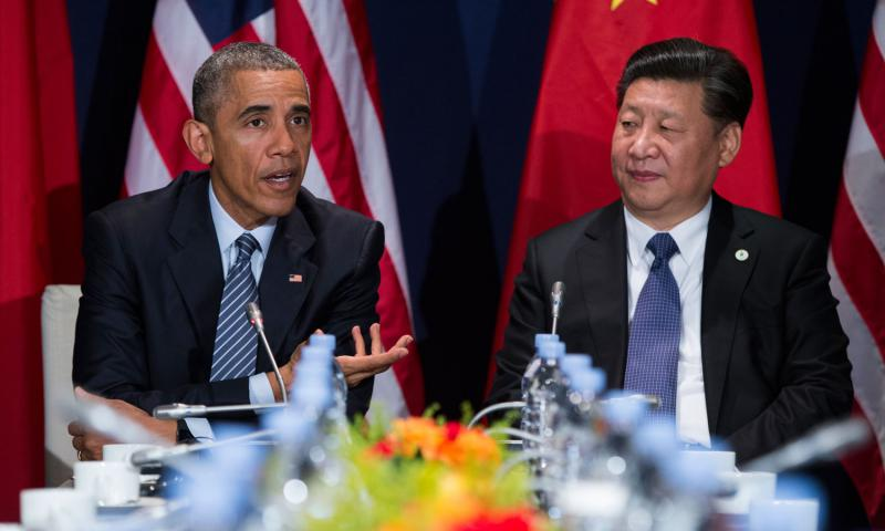 In this photo taken Nov. 30, 2015, President Barack Obama meets with Chinese President Xi Jinping in Le Bourget, France. A trade deal that is a centerpiece of Obama's efforts to counter Chinese influence in Asia hangs in the balance as he makes his last visit to Asia as president. Evan Vucci/AP Photo