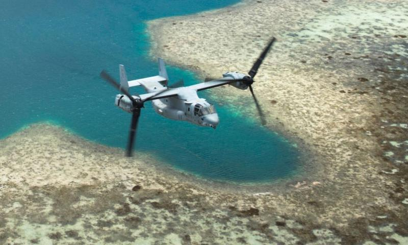 An MV-22 Osprey tiltrotor aircraft flies over the Northern Marianas Islands, Aug. 13, 2015. The Department of Navy has ordered further environmental study ahead of a proposed training facilities expansion on the U.S. commonwealth's Tinian and Pagan islands in the northern Pacific.  Courtesy of the U.S. Navy