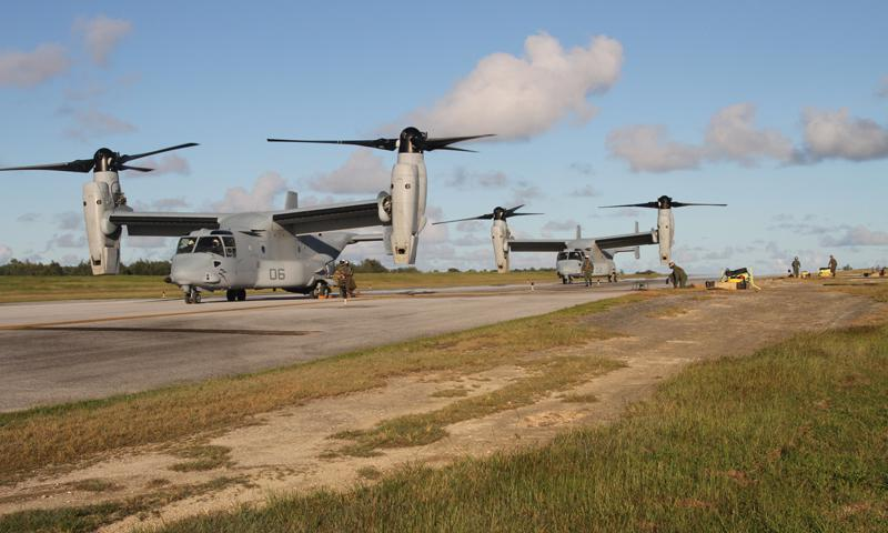 Two MV-22B Ospreys receive fuel on West Field here Dec. 10 during exercise Forager Fury 2012. These were the first Ospreys to land on Tinian which marks another milestone achieved during the exercise. The aircraft are with Marine Medium Tiltrotor Squadron 265, Marine Aircraft Group 36, 1st Marine Aircraft Wing, III Marine Expeditionary Force. (U.S. Marine Corps photo by Lance Cpl. J. Gage Karwick)