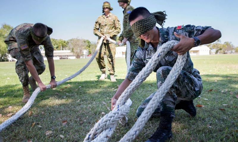 Chinese People's Liberation Army Cpl. Xing Wang unties a knot during team-building activities as part of Kowari 2016 at Larrakeyah Barracks in Darwin, Northern Territory. Kowari is an Australian army-hosted survival skills exercise designed to increase defense cooperation between forces from the U.S., Australia and China. Jake Sims/Australia Defence Force